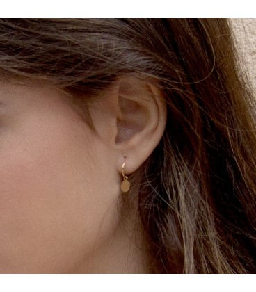 Gold hoop earrings with circle