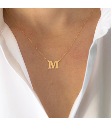 Necklace with initial in gold
