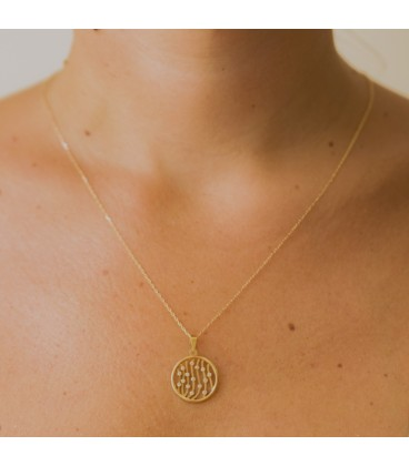 Gold circle and zirconia pendant