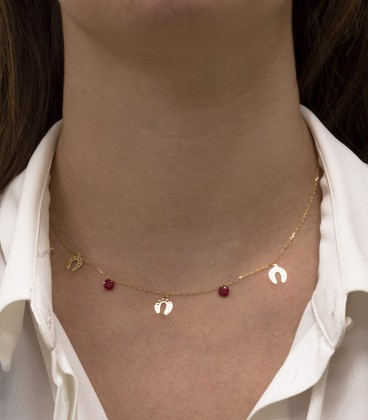 Necklace with horseshoes and stones in 18k gold quartz crystal color