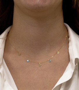 Necklace with circles and stones in 18k gold quartz crystal colour