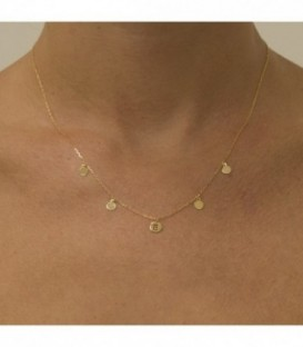 Necklace with a veneer and initial and circles