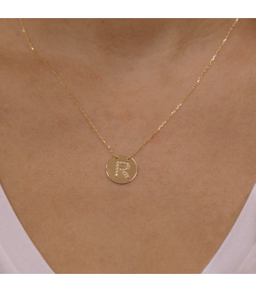 Necklace with initial badge and zirconia