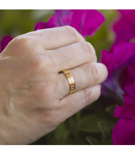 Wide wedding rings in bright and matte gold with exterior engraving