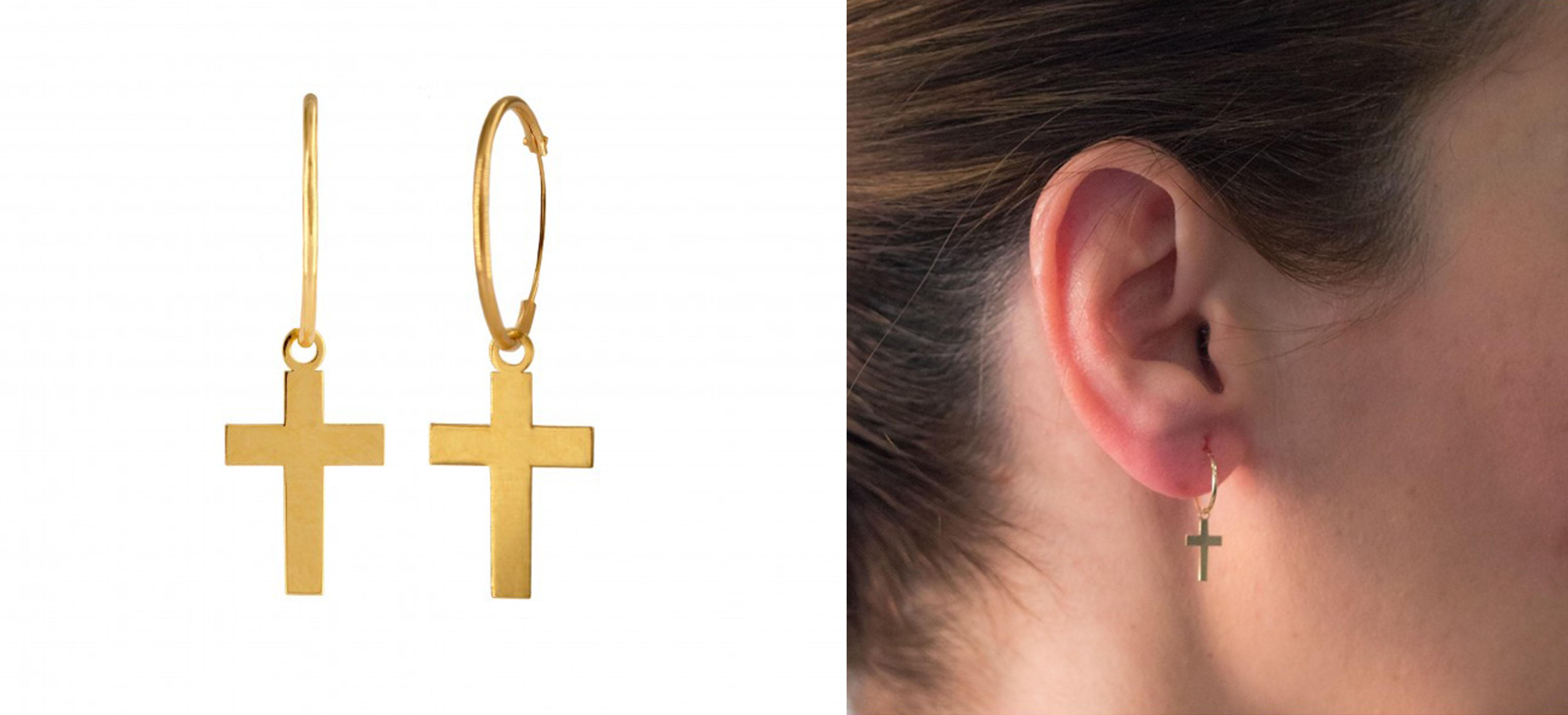 Aros con cruz en oro de varios tamaños: pequeño, mediano y grande.