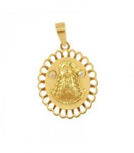 Medalla de la Virgen de la Blanca Paloma con forma ovalada y borde redondeado. Además, tiene dos circonitas a la altura de la cabeza.